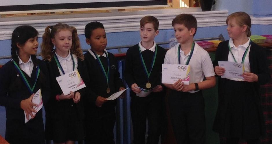 Receiving medals for taking part in a competition