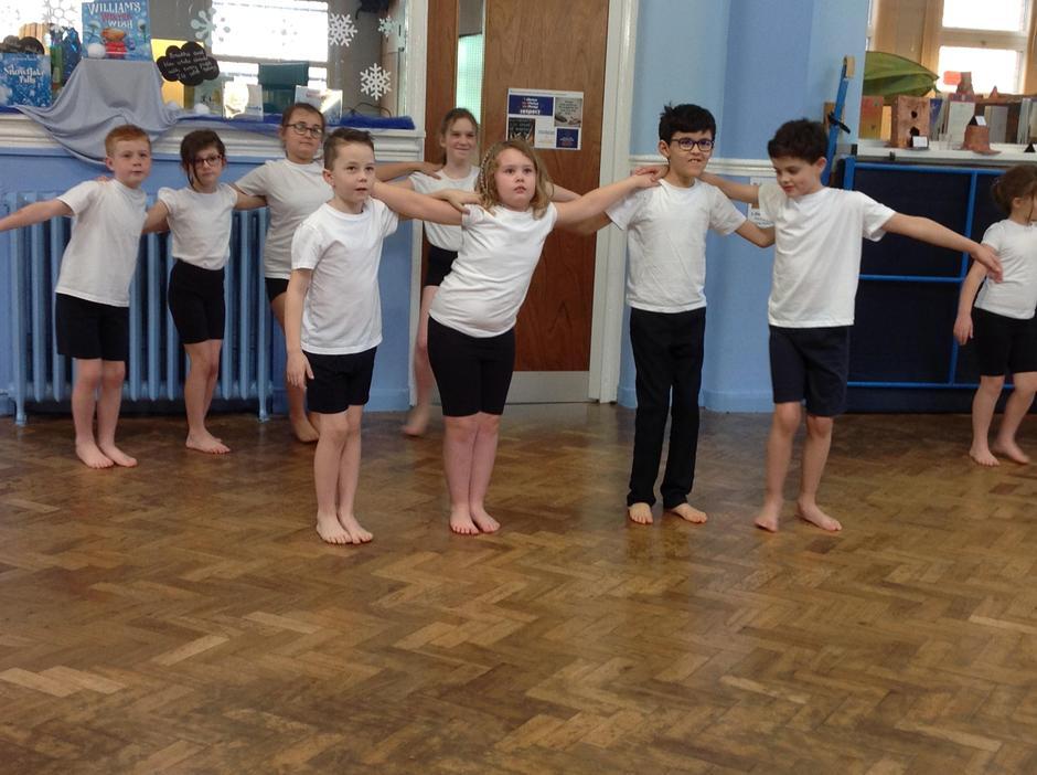 Mastering feet flicks in Taditional Greek dance.