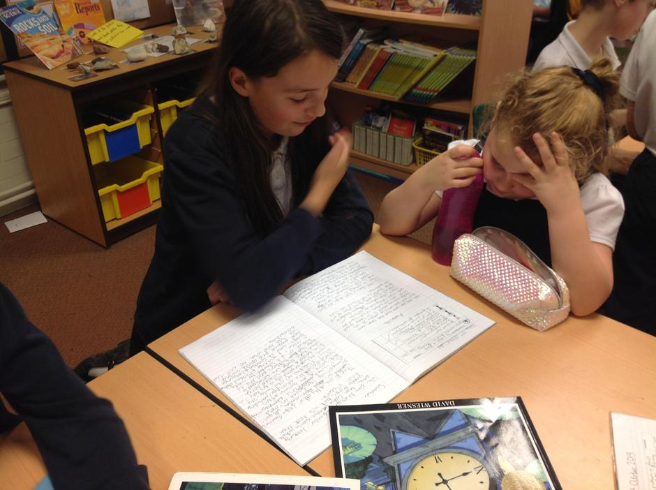 Year 6 sharing their writing with year 3