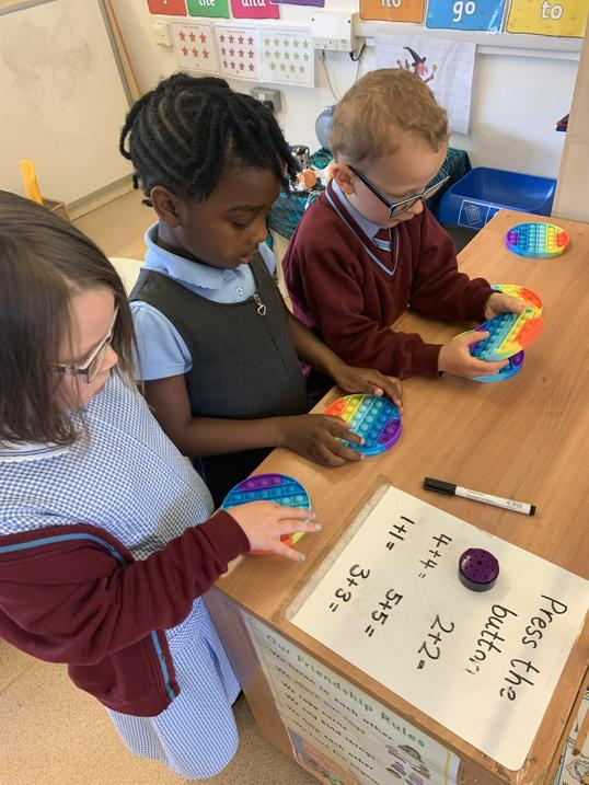 The children have been adding double numbers using the 'Poppits'.