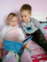 Reading with my big sister!