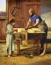 St Joseph with Jesus in his carpenters shop.