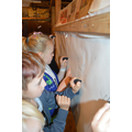 making cave paintings using charcoal