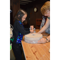 grinding grain using a rotary quern