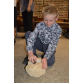 grinding grain using a saddle quern