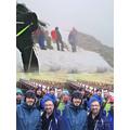 The Extreme Team climbing through the rain