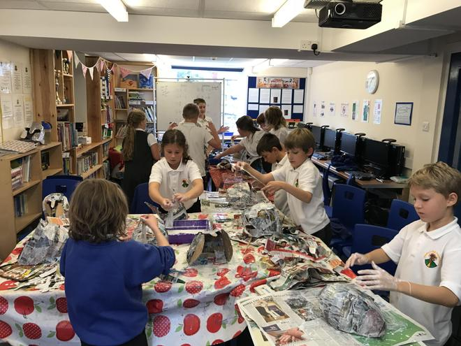 The class busy making their helmets