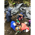 Mud pies, rain catchers and paintings on a wet day