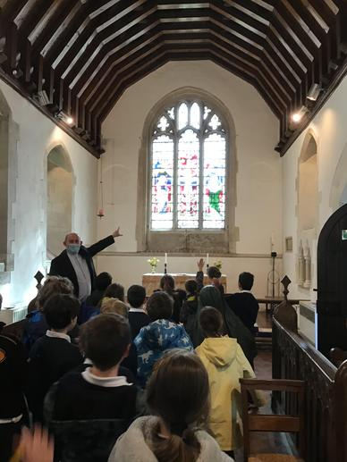 Father Simon talked us through who was depicted in each window