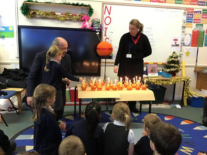 Learning about the Christingle with rev Simon Taylor, Dec 2019