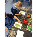 Painting our leaves using different water colours.