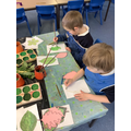 Using pastels to create the leaf veins and stem.