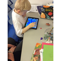 Using an I-Pad to create an ocean for the fish.