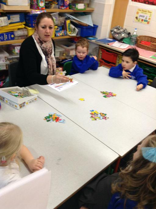 Counting puzzles pieces in piles of 10.