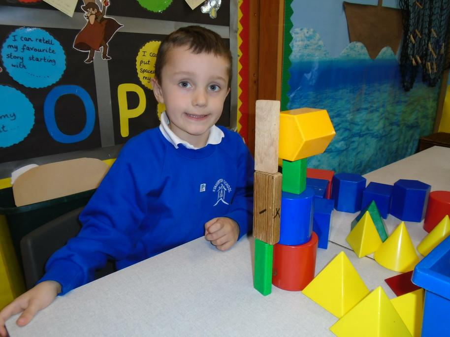 Alfie was creating with 3d shapes.