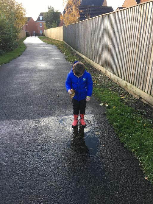 Enjoying the puddle and noticing the ripples.