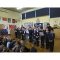 Reading Ambassadors present books to Class Teacher