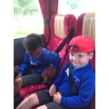 Conor and Adrea looking after Buddy on the bus.