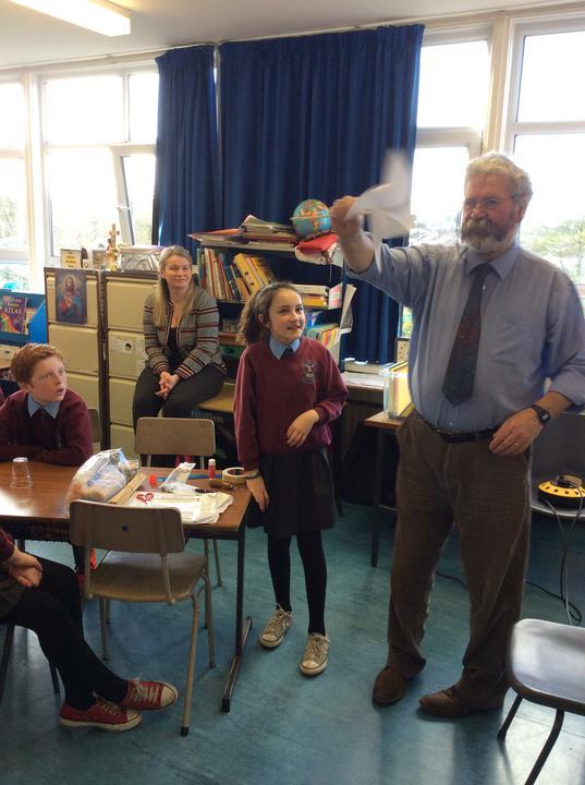 Stifle helps Peter test a windmill