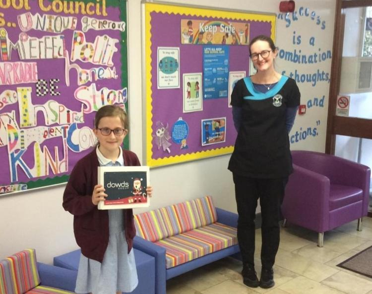 Lucia received her prize for second place in designing a Christmas Card competition.