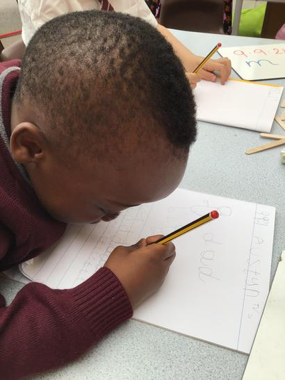 Practicing handwriting during a phonics session