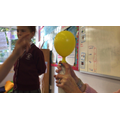 Capturing the gas (carbon dioxide) in a balloon.