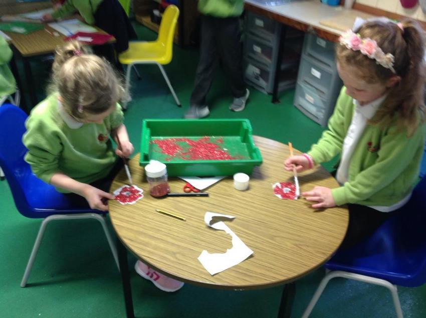 """We had so much fun making poppies for our class """"poppy wreath."""""""