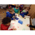 We used paint ice cubes to make messy pictures!