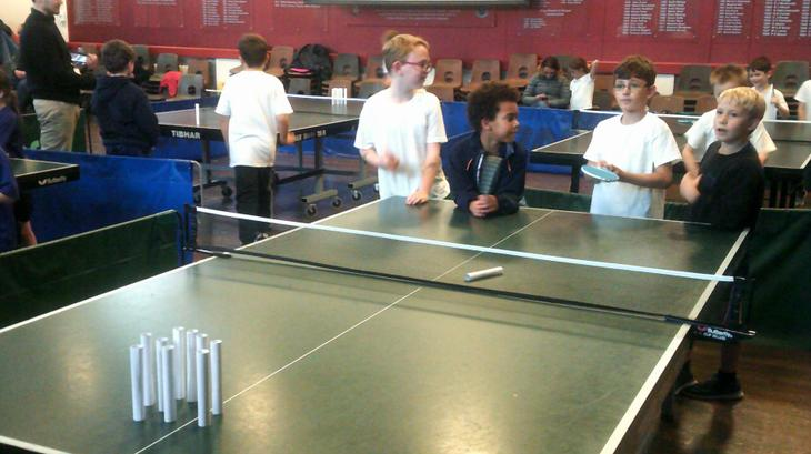 A game of table tennis bowling.