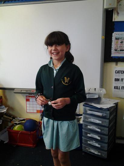 Alice received an award for great efforts in archery. Super!