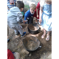 Digging for worms in the mud kitchen...