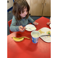 Year 1- Adding yoghurt to our prepared fruit.