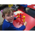 The children are making numbers using the multi-link cubes.