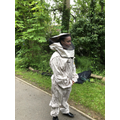 Miss Atkins in a beekeeper suit