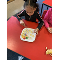 Year 1- Cutting our fruit for our yoghurts.