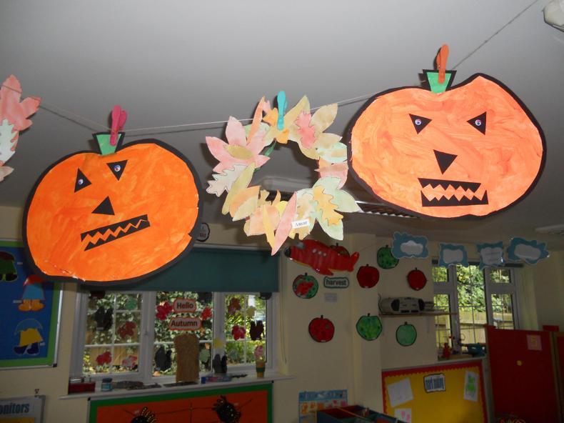 Harvest wreaths and Halloween oumpkins.