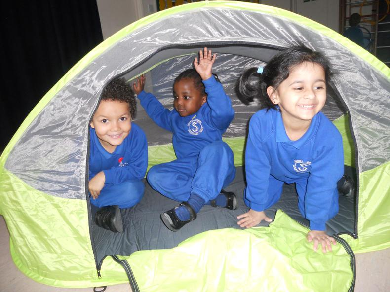 Having fun in the small tent.
