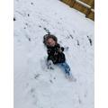 Isla Mae making a snow angel