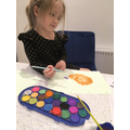 Emilie painting a snail in the rain for our 'ai' sound