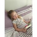 Emilie doing her reading challenge