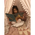 Evie reading in her tent