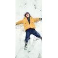 Eden making a snow angel