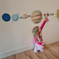 Harley made all the planets and stuck on them on her wall