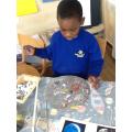 Axel busy painting hi moon