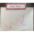 Isla Mae writing the letter i