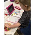Emilie working hard on her maths