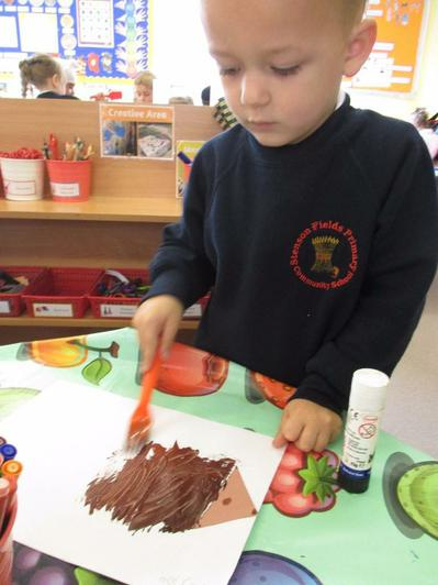 Painting a picture of the hedgehog.