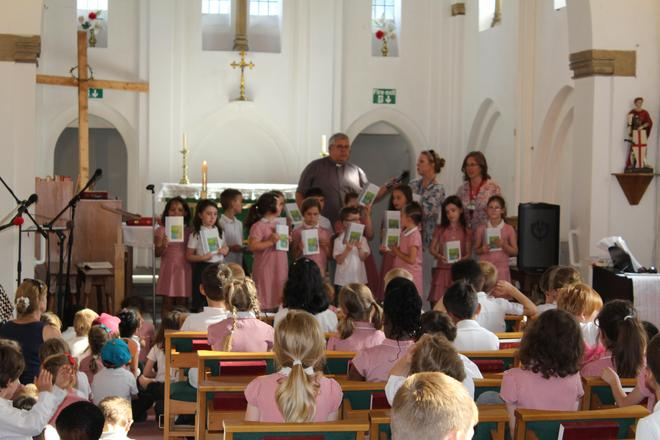 FROG Club receiving Prayer Books from church