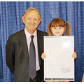 Ava with Sir Henry collecting her prize