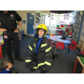 Reuben in Willow Class trying the uniform on.